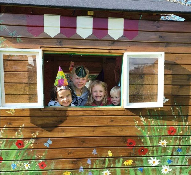 Some of Mary Nohilly's grandchildren are enjoying their new playhouse