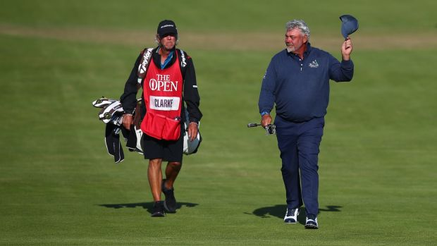Darren Clarke salutes the crowd as he walks up to the 18th green. Photograph: Christopher Lee/Getty Images