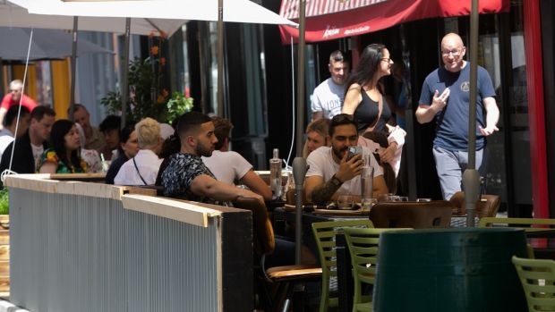 People enjoying the good weather outside restaurants on Capel Street in Dublin on Friday. Photograph: Gareth Chaney/Collins