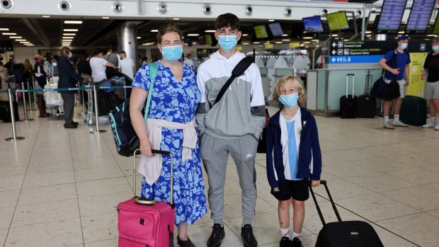 Dearbhla Lawlor, with her children Bobby and Donacha, prepares to depart at Dublin Airport. Photograph: Dara Mac Donaill