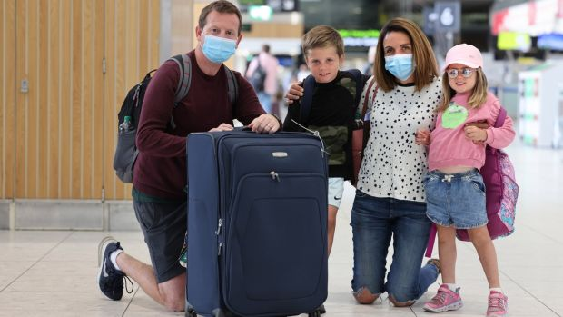 Patrick and Catherine McGettigan, from Terenure with children Danny and Lucy prepare to depart for Portugal. Photograph: Dara Mac Dónaill