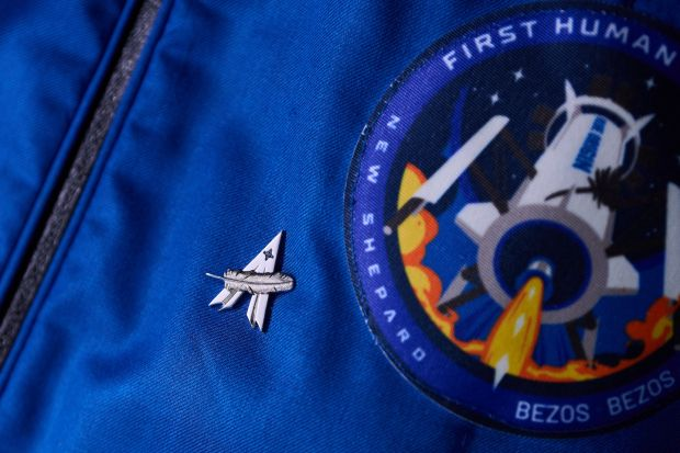 A Blue Origin astronaut's pin on Jeff Bezos's flight suit. Photograph: Blue Origin via New York Times