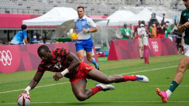 Kenya's Willy Ambaka scores a try against Ireland. Photo: Shuji Kajiyama/AP Photo