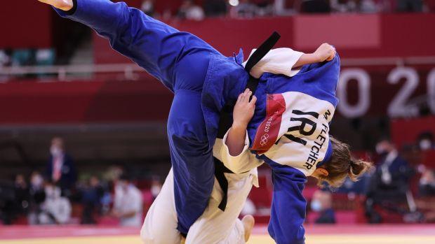 Ireland's Megan Fletcher (blue) in action against Michaela Pollerees of Austria. Photo: James Crombie/Inpho