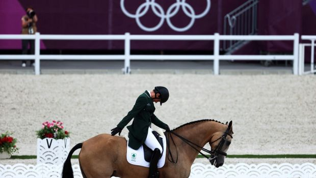 Ireland's Sam Watson riding Flamenco salutes the judges at the end of his performance in the equestrian eventing individual dressage. Photo: Behrouz Mehri/AFP via Getty Images