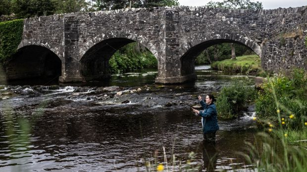 Danni Barry fishing for trout in the Slaney river. Photograph: Liosa McNamara