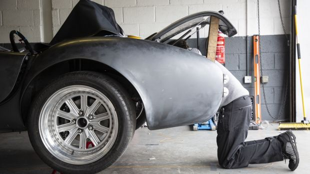 At work on the Cobra's compact rear end.