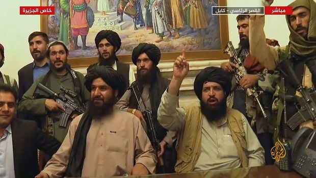 Members of theTaliban inthe presidential palace in Kabul on Monday. Photograph: Al Jazeera/AFP via Getty Images