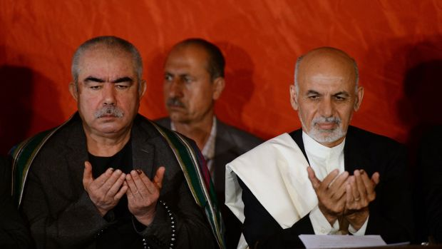 Then presidential candidate Ashraf Ghani (right) with his vice-presidential candidate, Abdul Rashid Dostum, in 2014. Photograph: Shah Marai/AFP via Getty Images