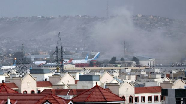 Smoke rises from an explosion outside the airport in Kabul, Afghanistan, on Thursday. Photograph: AP Photo/Wali Sabawoon