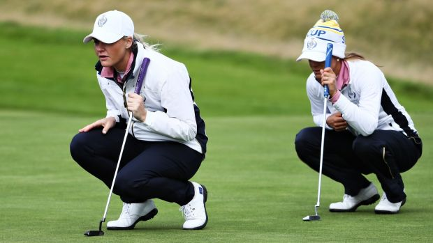 Charley Hull and Azahara Munoz line up putts at the Solheim Cup 2019 in Gleneagles.  Photo: Jamie Squire / Getty Images