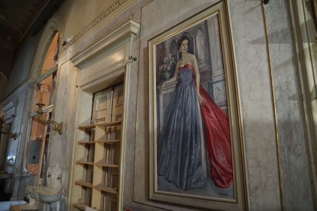 A portrait of Lady Yvonne Cochrane Sursock hangs in the lower parlor of Sursock Palace.  Photography: Hannah McCarthy