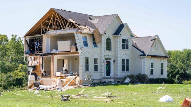 Storm Ida: A home damaged by a tornado in New Jersey. Photograph: Branden Eastwood/AFP/Getty Images