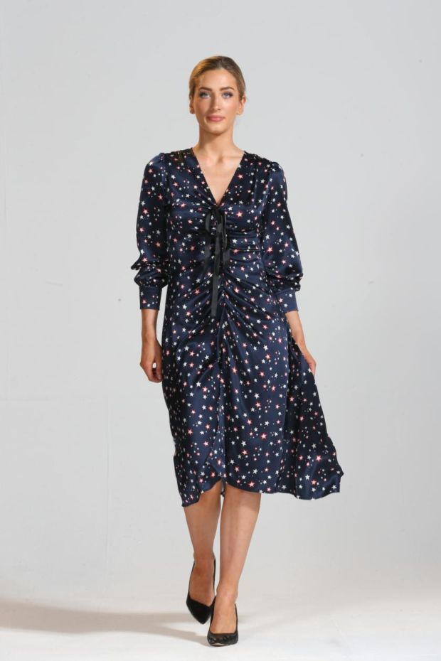 Star print silk satin dress with bow and ruched detail (€395), Niamh O'Neill