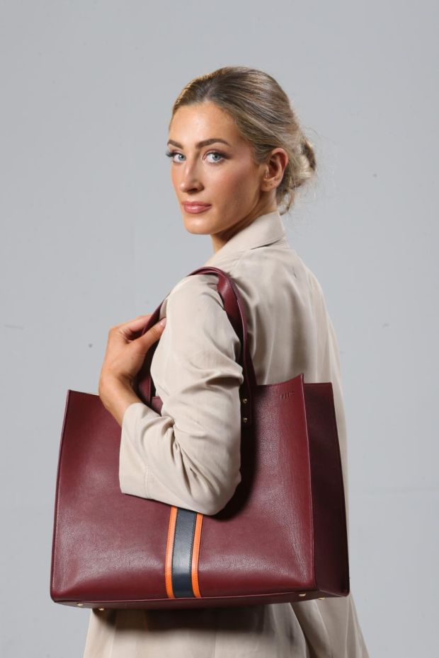 Large striped tote in Italian leather with orange stripe and magnetic closure (€265), by Julie Peelo