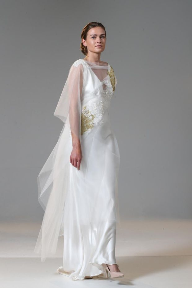 Low-back bias-cut dress in light ivory silk satin (€2,450), with applique lace tulle tunic (€1,250), by Delphine Grandjouan