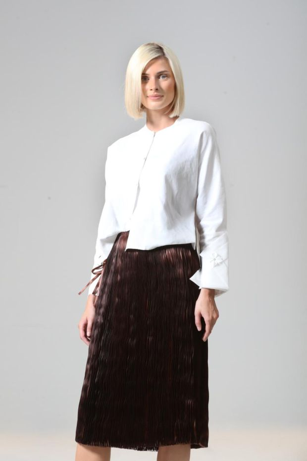 White organdie and poplin shirt with handstitched detail (€485) and ribbon skirt (€860), by Helen Hayes