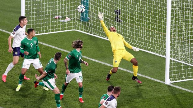 Serbian Sergej Milinkovic-Savic scores ahead of Irish goalkeeper Gavin Bazunu.  Photo: Laszlo Geczo / Inpho
