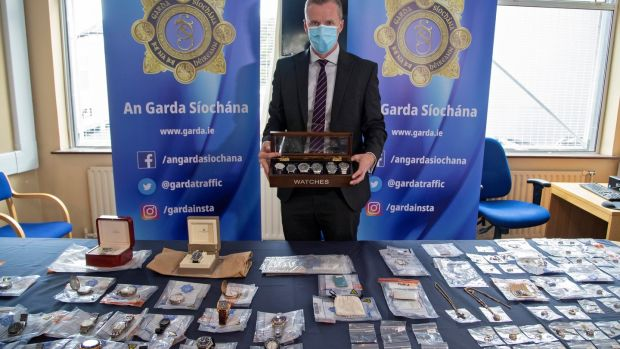 Insp Jason Miley of Crumlin station with some of the items the force hopes to return to rightful owners. Photograph: Collins
