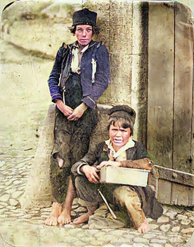 Two young boys (or maybe a girl and a boy) at Richmond Barracks, Templemore, Co Tipperary just after the 1845-1852 Great Famine.  Photography: Getty Museum, Open Content from Old Ireland in Color 2
