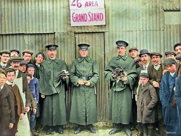 The day after the Home Rule meeting addressed by Winston Churchill, showing three policemen holding bundles of empty handbags and surrounded by a group of spectators in Celtic Park, Belfast.  Photograph: National Museum of Northern Ireland of Old Ireland in color 2