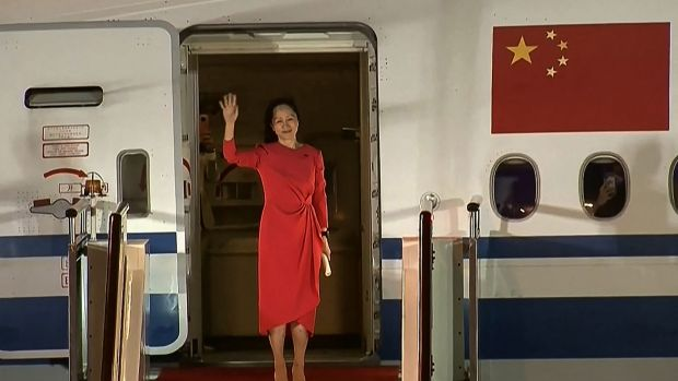 Huawei executive Meng Wanzhou waves as she steps out of a plane upon arrival in Shenzhen in China. Photograph: CCTV/AFP via Getty Images