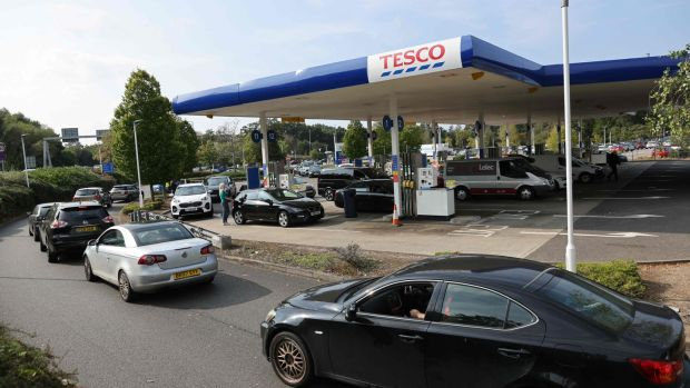 A line of vehicles at a petrol station in Camberley, west of London. Photograph: Adrian Dennis/AFP via Getty