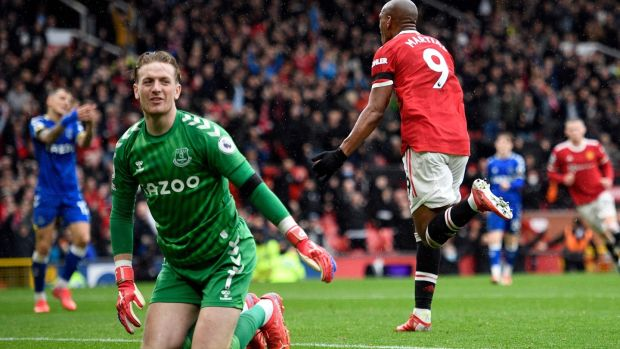 Jordan Pickford reacts as Anthony Martial celebrates. Photo: Oli Scarff/AFP via Getty Images