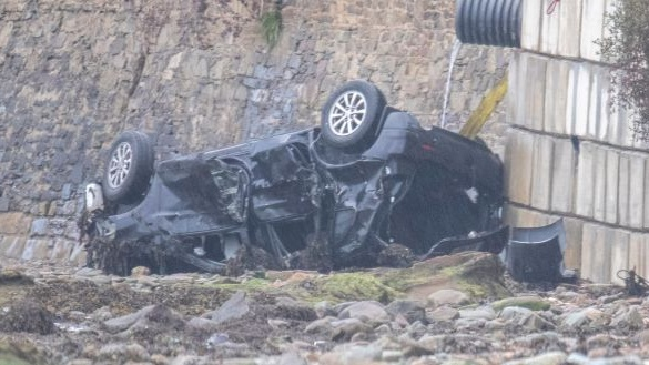 The car the Mullan family was travelling in is seen at the crash site at Quigley's Point in Co Donegal. Photograph: North West Newspix
