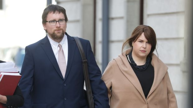 Stephen and Deirdre Feely leaving the Four Courts on Tuesday after a High Court action on behalf of their son Fionn was settled. Photograph: Paddy Cummins/IrishPhotoDesk.ie