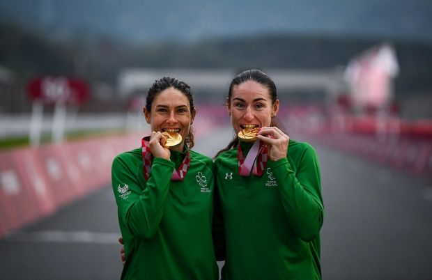 Katie-George Dunlevy and Eve McCrystal celebrate with their gold medals following the Women's B Time Trial at the Paralympic Games in Tokyo. Photograph: David Fitzgerald/Sportsfile