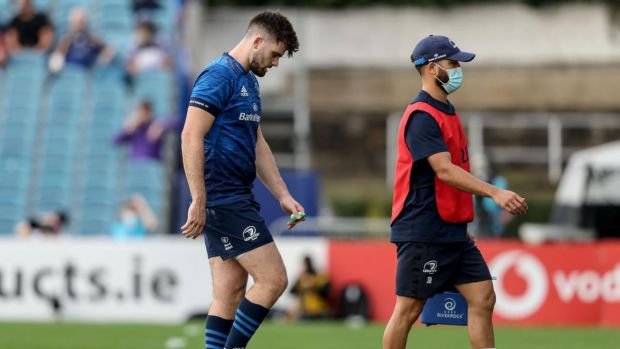 Leinster's Harry Byrne leaves the field due to an injury. Photograph: Dan Sheridan/Inpho
