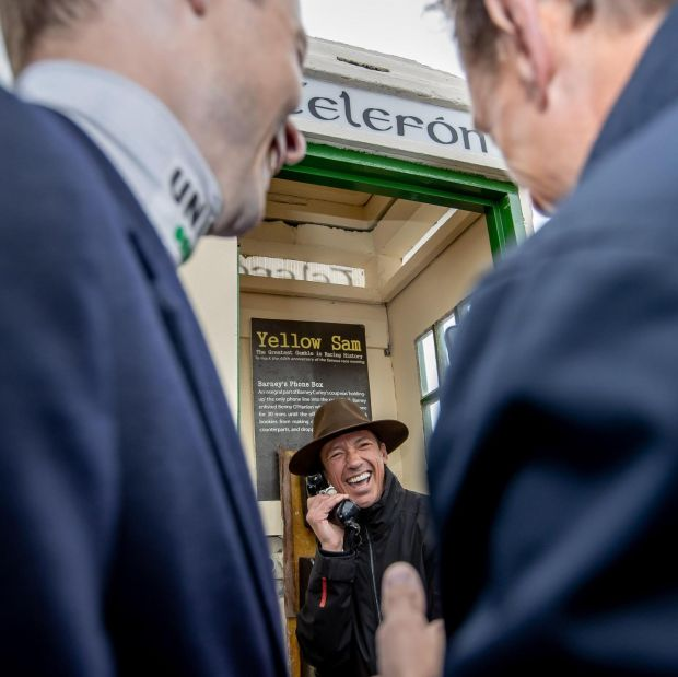 Frankie Dettori in the phone box at Bellewstown Racecourse last month. He was auctioning off Barney Curley's fedora. Photograph: Morgan Treacy/Inpho