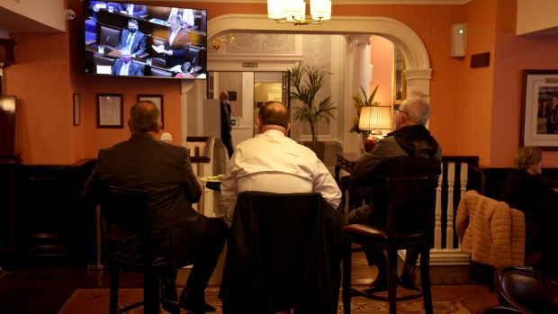 Watching Budget 2022 being announced on television in Buswells Hotel, Dublin. Photograph: Dara Mac Dónaill