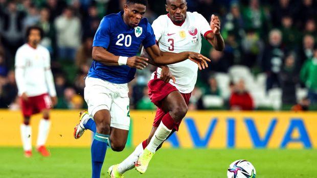 Ireland's Chiedozie Ogbene runs past Abdelkarim Hassan of Qatar during the friendly international at the Aviva Stadium. Photograph: Morgan Treacy/Inpho