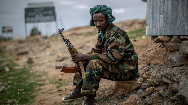 A fighter loyal to the Tigray People's Liberation Front mans a guard post on the outskirts of the town of Hawzen last May. Photograph: Ben Curtis/AP