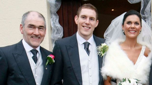 Mickey Harte with daughter Michaela and son-in-law John McAreavey on their wedding day in Ballymacilroy, Co Antrim in January 2011. 'He was one of our family. He was special in Michaela's life so he is always going to be special in our lives too.' Photograph: Irish News