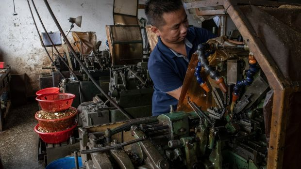Hu Jiyan at his workshop, which has been plagued by power cuts, in Dongguan. Photograph: Gilles SabriŽ/The New York Times